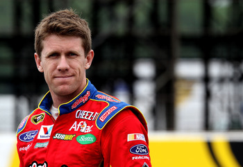 LONG POND, PA - JUNE 11:  Carl Edwards, driver of the #99 Kellogg / Cheez-it Ford waits on pit road during qualifying for the NASCAR Sprint Cup Series 5-Hour Energy 500 at Pocono Raceway on June 11, 2011 in Long Pond, Pennsylvania.  (Photo by Jerry Markla