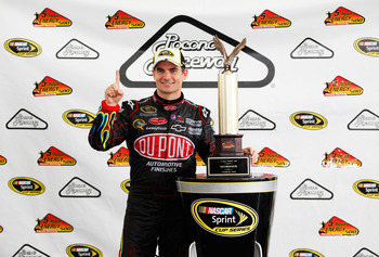 LONG POND, PA - JUNE 12:  Jeff Gordon, driver of the #24 DuPont Chevrolet, celebrates with the trophy after winning the NASCAR Sprint Cup Series 5-Hour Energy 500 at Pocono Raceway on June 12, 2011 in Long Pond, Pennsylvania.  (Photo by Geoff Burke/Getty
