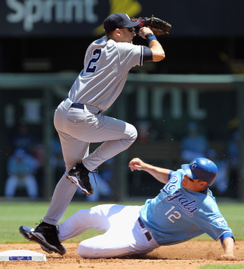KANSAS CITY, MO - AUGUST 15:  Shortstop Derek Jeter #2 of the New York Yankees turns a double play as Mitch Maier #12 of the Kansas City Royals slides into second during the game on August 15, 2010 at Kauffman stadium in Kansas City, Missouri.  (Photo by