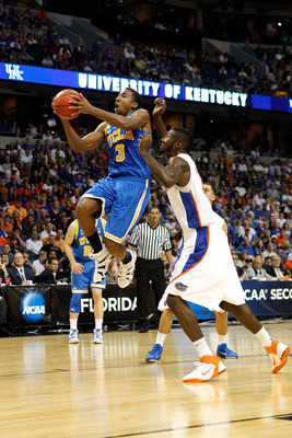 TAMPA, FL - MARCH 19:  Malcolm Lee #3 of the UCLA Bruins drives for a shot attempt against Patric Young #4 of the Florida Gators during the third round of the 2011 NCAA men's basketball tournament at St. Pete Times Forum on March 19, 2011 in Tampa, Florid