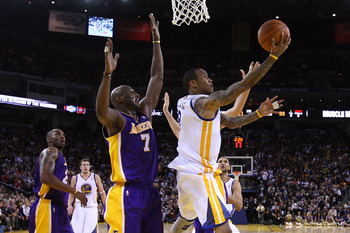 OAKLAND, CA - JANUARY 12: Monta Ellis #8 of the Golden State Warriors goes up for a shot on Lamar Odom #7 of the Los Angeles Lakers at Oracle Arena on January 12, 2011 in Oakland, California. NOTE TO USER: User expressly acknowledges and agrees that, by d