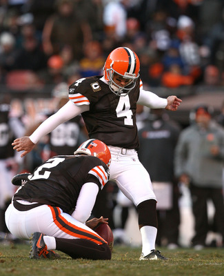 CLEVELAND - NOVEMBER 28:  Punter Reggie Hodges #2 holds as kicker Phil Dawson #4 of the Cleveland Browns kicks a fourth quarter field goal against the Carolina Panthers at Cleveland Browns Stadium on November 28, 2010 in Cleveland, Ohio.  (Photo by Matt S