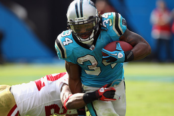 CHARLOTTE, NC - OCTOBER 24:  DeAngelo Williams #34 of the Carolina Panthers runs with the ball against the San Francisco 49ers during their game at Bank of America Stadium on October 24, 2010 in Charlotte, North Carolina.  (Photo by Streeter Lecka/Getty I