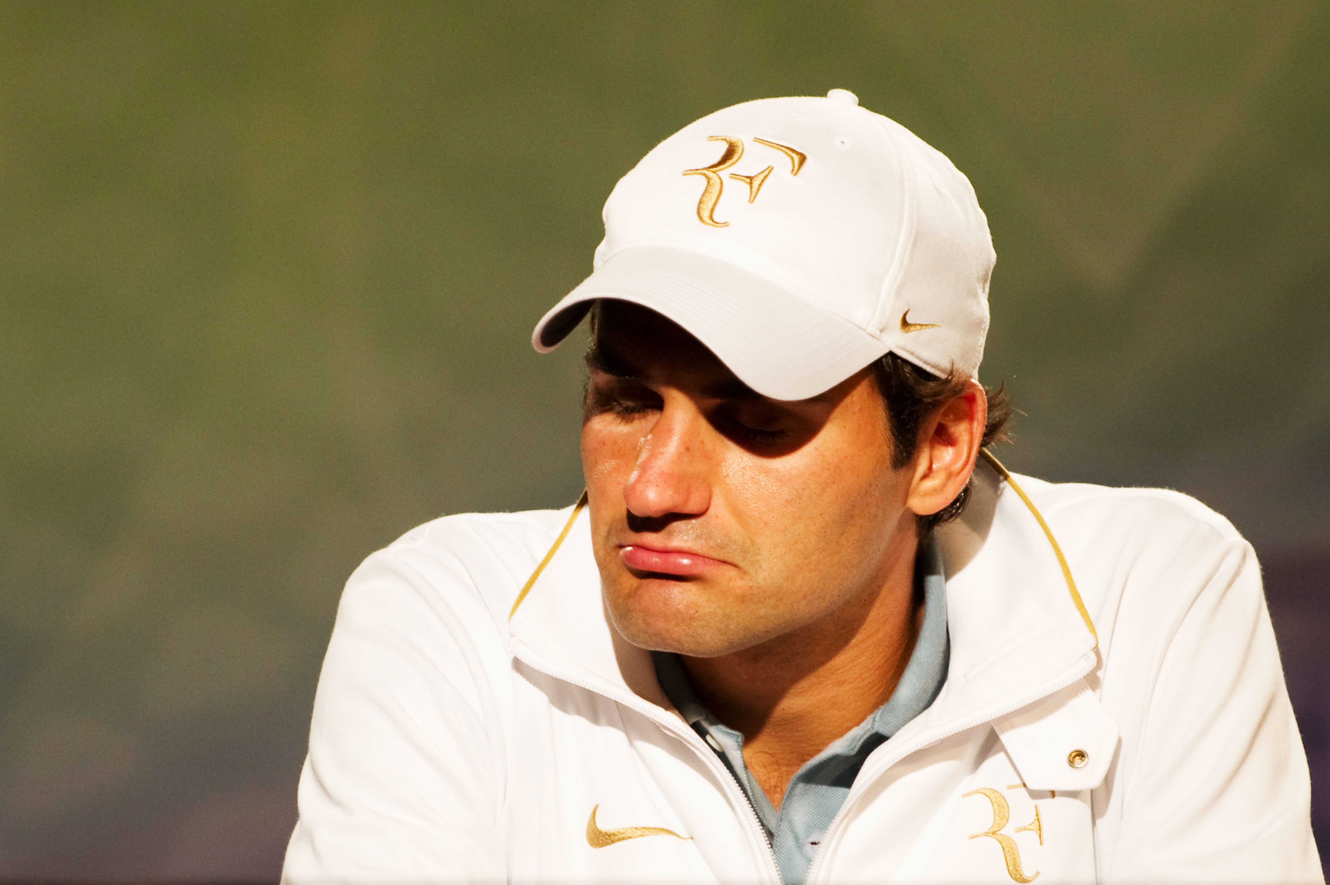 LONDON, ENGLAND - JUNE 30:  Roger Federer of Switzerland speaks during a press conference on Day Nine of the Wimbledon Lawn Tennis Championships at the All England Lawn Tennis and Croquet Club on June 30, 2010 in London, England.  (Photo by Tom Lovelock-P