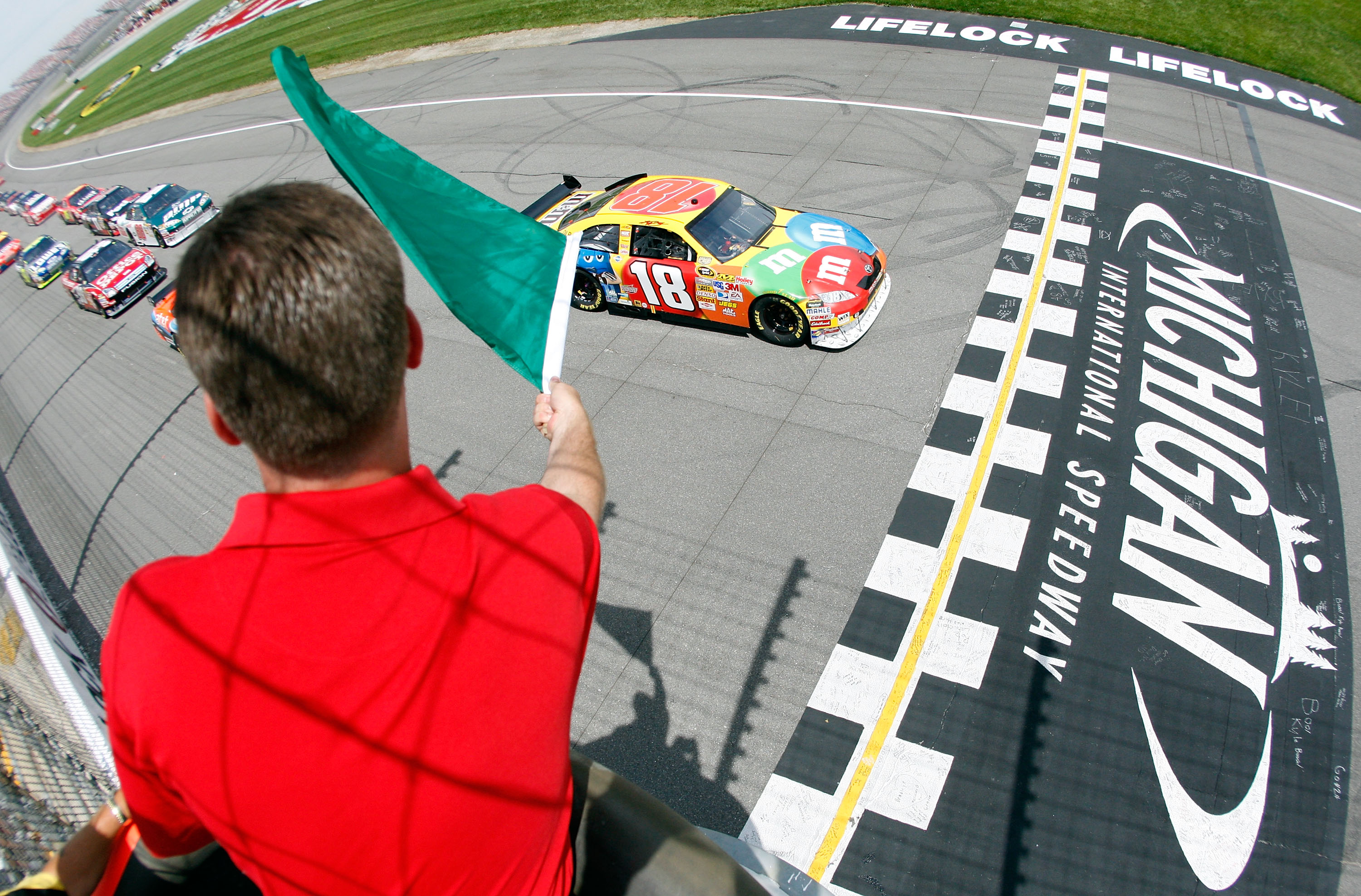 BROOKLYN, MI - JUNE 15:  Kyle Busch, driver of the #18 M&M's Toyota, crosses the start line at the green flag during the NASCAR Sprint Cup Series Lifelock 400 at the Michigan International Speedway on June 15, 2008 in Brooklyn, Michigan.  (Photo by Chris