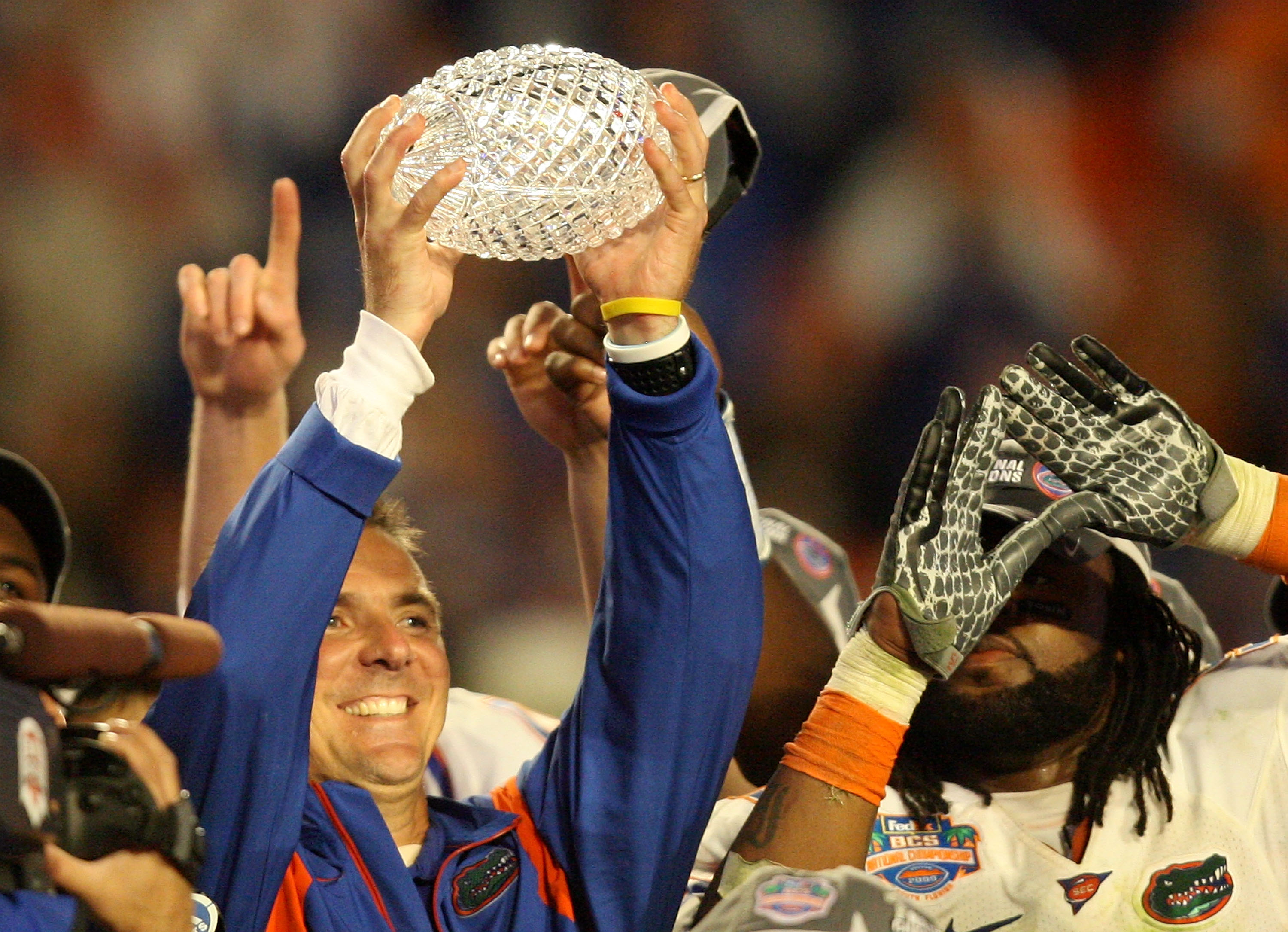 MIAMI - JANUARY 08:  Head coach Urban Meyer of the Florida Gators celebrates with the National Championship trophy after therir 24-14 win against the Oklahoma Sooners during the FedEx BCS National Championship game at Dolphin Stadium on January 8, 2009 in