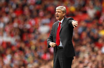 LONDON, ENGLAND - MAY 15:  Arsene Wenger manager of Arsenal issues instructions to his players during the Barclays Premier League match between Arsenal and Aston Villa at the Emirates Stadium on May 15, 2011 in London, England.  (Photo by Richard Heathcot