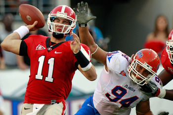 JACKSONVILLE, FL - OCTOBER 30:  Quarterback Aaron Murray #11 of the Georgia Bulldogs attempts a pass while being pressured by Justin Trattou #94 of the Florida Gators during the game at EverBank Field on October 30, 2010 in Jacksonville, Florida.  (Photo