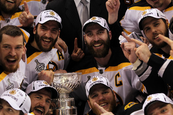 VANCOUVER, BC - JUNE 15:  Patrice Bergeron #37, Andrew Ference #21, Mark Recchi #28, Shawn Thornton #22 and Zdeno Chara #33 of the Boston Bruins pose with the Stanley Cup after defeating the Vancouver Canucks in Game Seven of the 2011 NHL Stanley Cup Fina