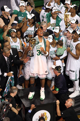 BOSTON - JUNE 17:  Paul Pierce #34 of the Boston Celtics celebrates with the NBA Finals MVP trophy after defeating the Los Angeles Lakers in Game Six of the 2008 NBA Finals on June 17, 2008 at TD Banknorth Garden in Boston, Massachusetts. NOTE TO USER: Us