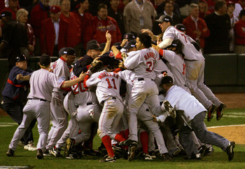 ST LOUIS - OCTOBER 27:  The Boston Red Sox celebrate after defeating the St. Louis Cardinals 3-0 to win game four of the World Series on October 27, 2004 at Busch Stadium in St. Louis, Missouri. (Photo by Elsa/Getty Images)