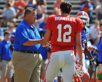 GAINESVILLE, FL - APRIL 9:  Offensive coordinator Charlie Weis of the Florida Gators directs play with quarterback John Bantley #12 during the Orange and Blue spring football game April 9, 2011 at Ben Hill Griffin Stadium in Gainesville, Florida.  (Photo