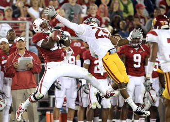 PALO ALTO, CA - OCTOBER 09:  Chris Owusu #81 of the Stanford Cardinal catches a ball over the outstreched arms of Jawanza Starling #29 of the USC Trojans at Stanford Stadium on October 9, 2010 in Palo Alto, California.  (Photo by Ezra Shaw/Getty Images)