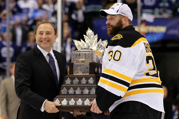 VANCOUVER, BC - JUNE 15:  NHL Commissioner Gary Bettman presents Tim Thomas #30 of the Boston Bruins with the Conn Smythe Trophy after defeating the Vancouver Canucks in Game Seven of the 2011 NHL Stanley Cup Final at Rogers Arena on June 15, 2011 in Vanc