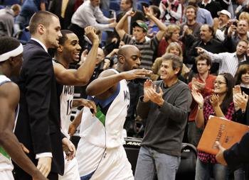 MINNEAPOLIS, MN - OCTOBER 28: Damien Wilkins #3 of the Minnesota Timberwolves celebrates with teammates and fans after scoring the game-winning shot at the buzzer against the New Jersey Nets at the Target Center on October 28, 2009 in Minneapolis, Minneso