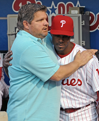 PHILADELPHIA - APRIL 17: Jimmy Rollins #11 of the Philadelphia Phillies hugs former player John Kruk during a tribute to recently departed Philadelphia Phillies announcer Harry Kalas before the game against the San Diego Padres on April 17, 2009 at Citize