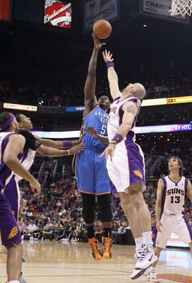 PHOENIX, AZ - MARCH 30:  Kendrick Perkins #5 of the Oklahoma City Thunder puts up a shot during the NBA game against the Phoenix Suns at US Airways Center on March 30, 2011 in Phoenix, Arizona. The Thunder defeated the Suns 116-98.   NOTE TO USER: User ex