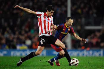 BARCELONA, SPAIN - FEBRUARY 20:  Andres Inieta of FC Barcelona (R) fights for the ball against Javi Martinez of Athletic Bilbao during the La Liga match between FC Barcelona and Athletic Bilbao at Camp Nou on February 20, 2011 in Barcelona, Spain. Barcelo