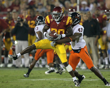 LOS ANGELES, CA - SEPTEMBER 11:  Wide receiver Brandon Carswell #80 of the USC Trojans makes a catch in front of cornerback Mike Parker #43 of the Virginia Cavaliers at Los Angeles Memorial Coliseum on September 11, 2010 in Los Angeles, California. USC wo