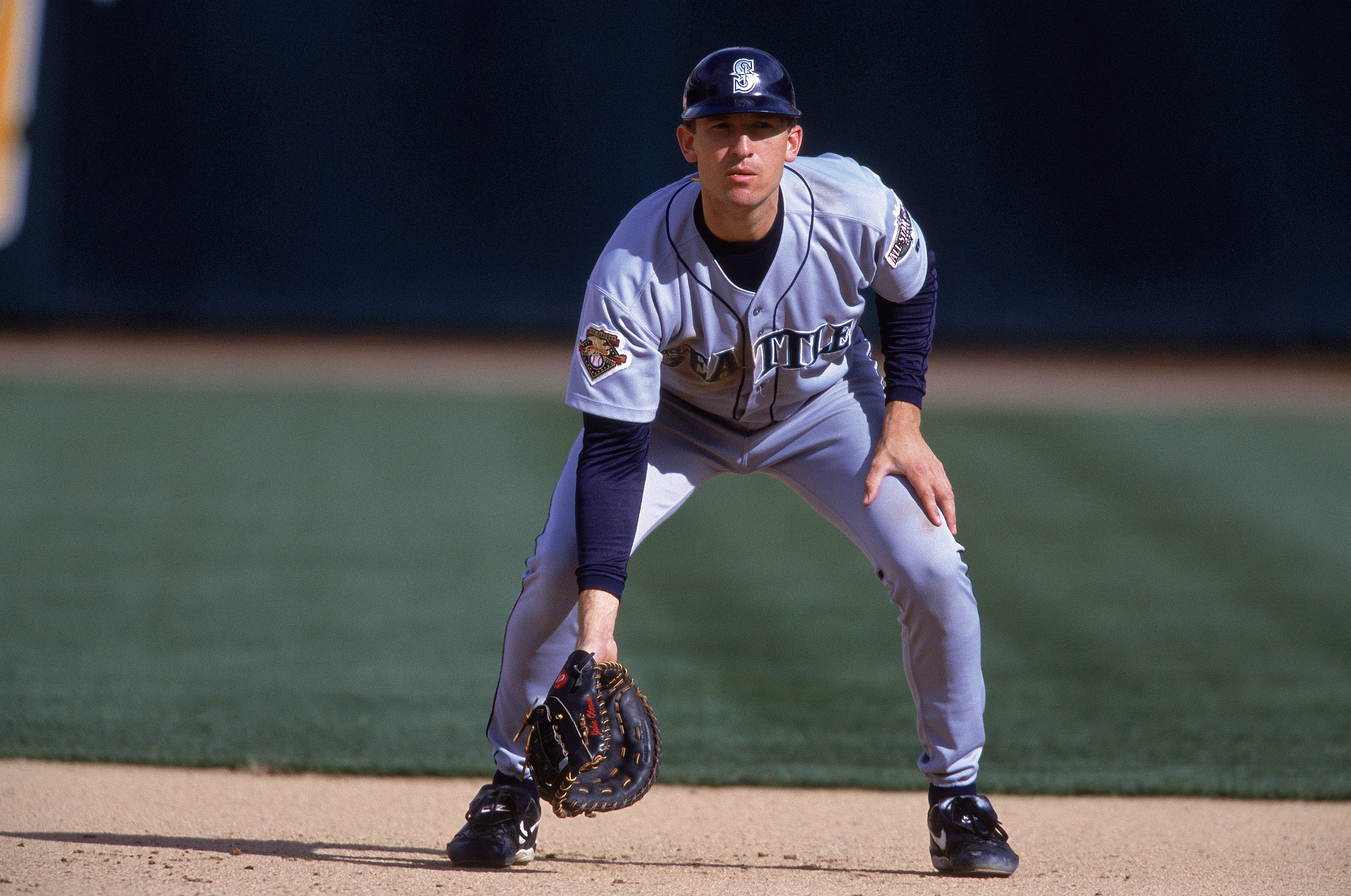 22 Sep 2001:  John Olerud #5 of the Seattle Mariners drops down to field the ball during the game against the Oakland Athletics at the Network Associates Coliseum in Oakland, California.  The Athletics defeated the Mariners 11-2.Mandatory Credit: Jed Jaco