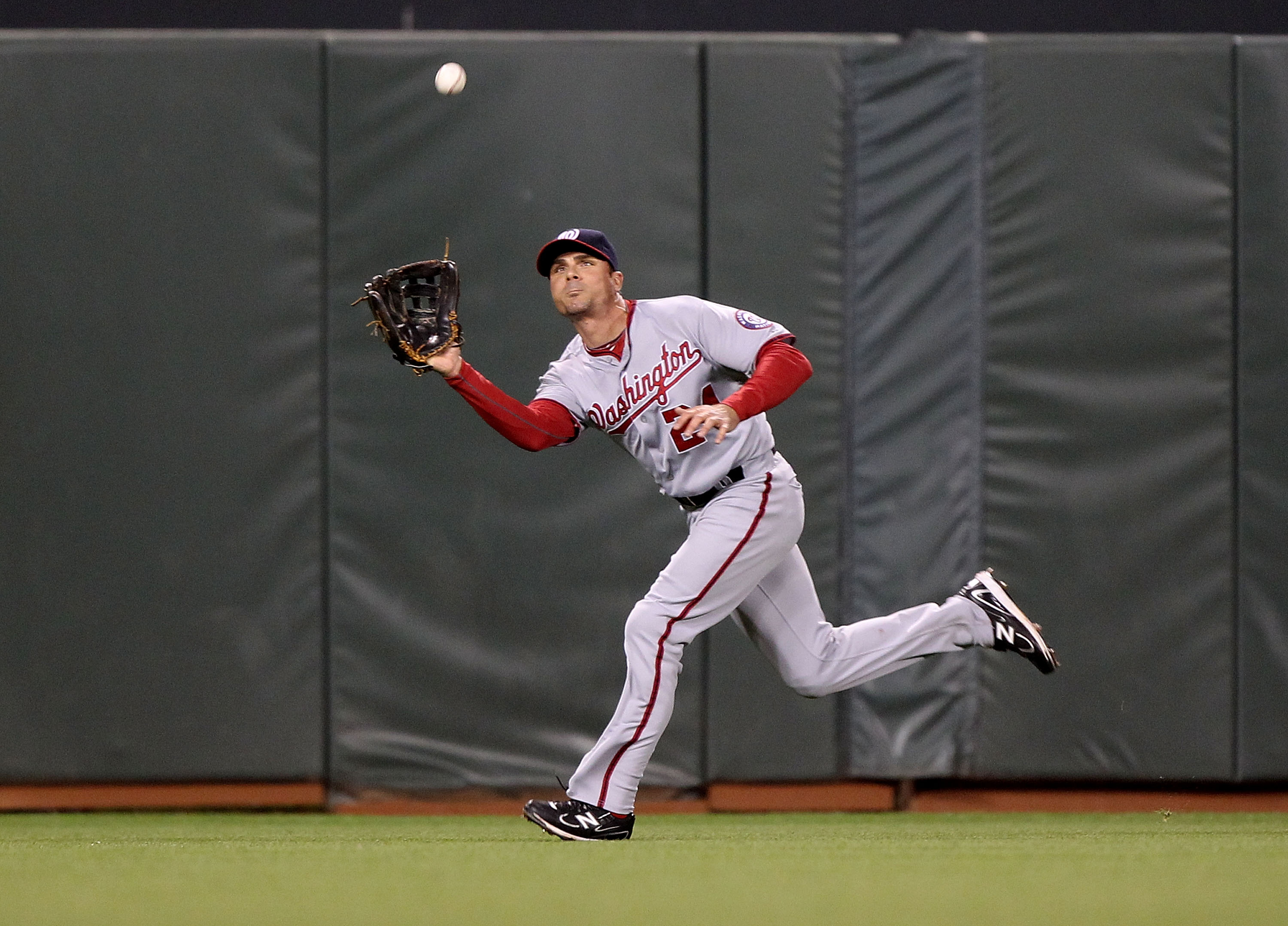 SAN FRANCISCO, CA - JUNE 07:  Rick Ankiel #24 of the Washington Nationals catches a ball hit by Aaron Rowand of the San Francisco Giants during an MLB game at AT&T Park on June 7, 2011 in San Francisco, California.  (Photo by Jed Jacobsohn/Getty Images)