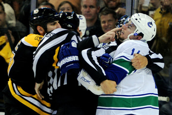 BOSTON, MA - JUNE 06:  Milan Lucic #17 of the Boston Bruins taunts Alex Burrows #14 of the Vancouver Canucks during Game Three of the 2011 NHL Stanley Cup Final at TD Garden on June 6, 2011 in Boston, Massachusetts.  (Photo by Harry How/Getty Images)