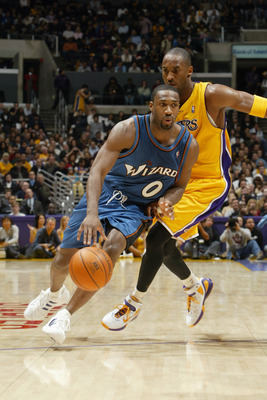 LOS ANGELES - DECEMBER 16:  Gilbert Arenas #0 of the Washington Wizards drives past Kobe Bryant #8 of the Los Angeles Lakers during a game at Staples Center on December 16, 2005 in Los Angeles, California.  The Lakers won 97-91.  NOTE TO USER:  User expre