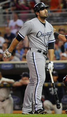 MINNEAPOLIS, MN - JUNE 15: Carlos Quentin #20 of the Chicago White Sox reacts to striking out against the Minnesota Twins during the ninth inning on June 15, 2011 at Target Field in Minneapolis, Minnesota. The Twins defeated the White Sox 4-1. (Photo by H