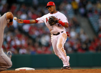 ANAHEIM, CA - JUNE 11:  Erick Aybar #2 of the Los Angeles Angels of Anaheim turns a double playto end the third inning against the Kansas City Royals on June 11, 2011 at Angel Stadium in Anaheim, California.  (Photo by Stephen Dunn/Getty Images)