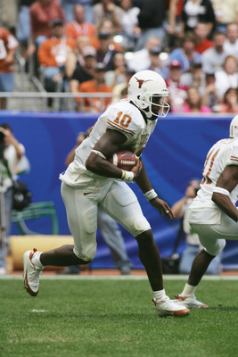 HOUSTON - DECEMBER 3:  Quarterback Vince Young #10 of the Texas Longhorns carries the ball against the Colorado Buffaloes during the Dr. Pepper Big 12 Championship at Reliant Stadium on December 3, 2005  in Houston, Texas. The Longhorns defeated the Buffa