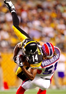 PITTSBURGH - AUGUST 29: Wide Reciver Limas Sweed #14 of the Pittsburgh Steelers makes a frist down catch in the first quarter tackled by Paul Posluszny #51 of the Buffalo Bills at Heinz Field on August 29, 2009 in Pittsburgh, Pennsylvania. (Photo by Grego