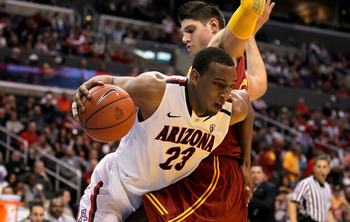 LOS ANGELES, CA - MARCH 11:  Derrick Williams #23 of the Arizona Wildcats drives on Nikola Vucevic #5 of the USC Trojans in the first half in the semifinals of the 2011 Pacific Life Pac-10 Men's Basketball Tournament at Staples Center on March 11, 2011 in