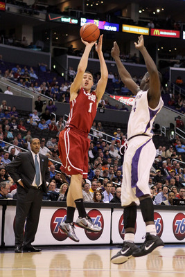 LOS ANGELES, CA - MARCH 10:  Klay Thompson #1 of the Washington State Cougars shoots over Darnell Gant #44 of the Washington Huskies in the first half in the quarterfinals of the 2011 Pacific Life Pac-10 Men's Basketball Tournament at Staples Center on Ma
