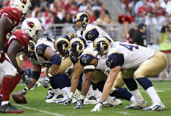 GLENDALE, AZ - DECEMBER 05:  Quarterback Sam Bradford #8 of the St. Louis Rams prepares to snap the ball during the NFL game against the Arizona Cardinals at the University of Phoenix Stadium on December 5, 2010 in Glendale, Arizona.  The Rams defeated th