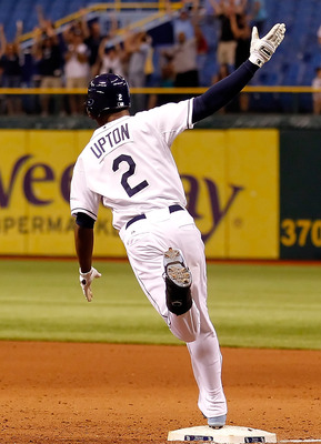ST. PETERSBURG, FL - MAY 03:  Outfielder B.J. Upton #2 of the Tampa Bay Rays celebrates his two run walkoff home run against the Toronto Blue Jays at Tropicana Field on May 3, 2011 in St. Petersburg, Florida.  (Photo by J. Meric/Getty Images)