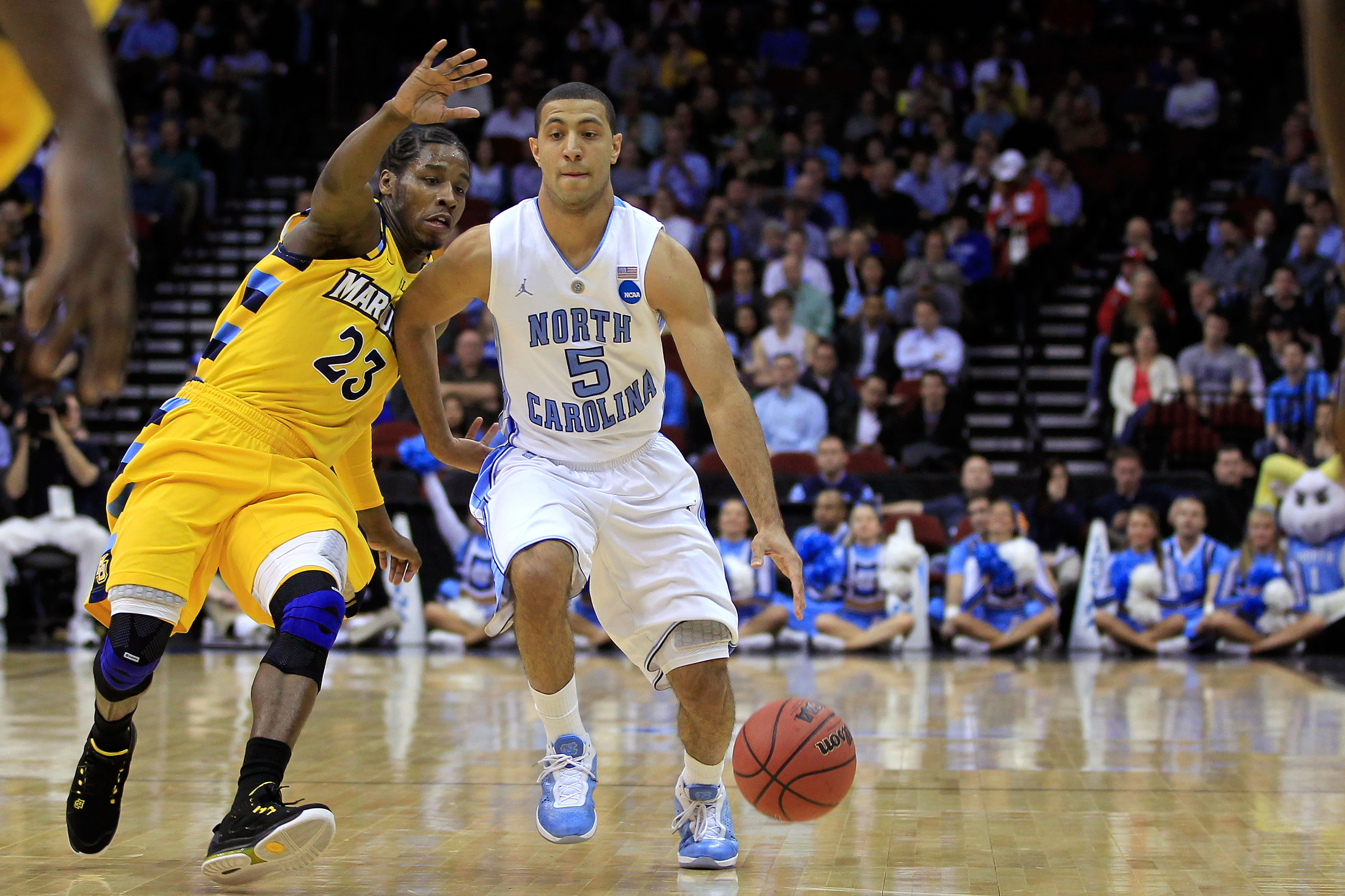 NEWARK, NJ - MARCH 25:  Kendall Marshall #5 of the North Carolina Tar Heels dribbles the ball against Junior Cadougan #5 of the Marquette Golden Eagles during the east regional semifinal of the 2011 NCAA Men's Basketball Tournament at the Prudential Cente