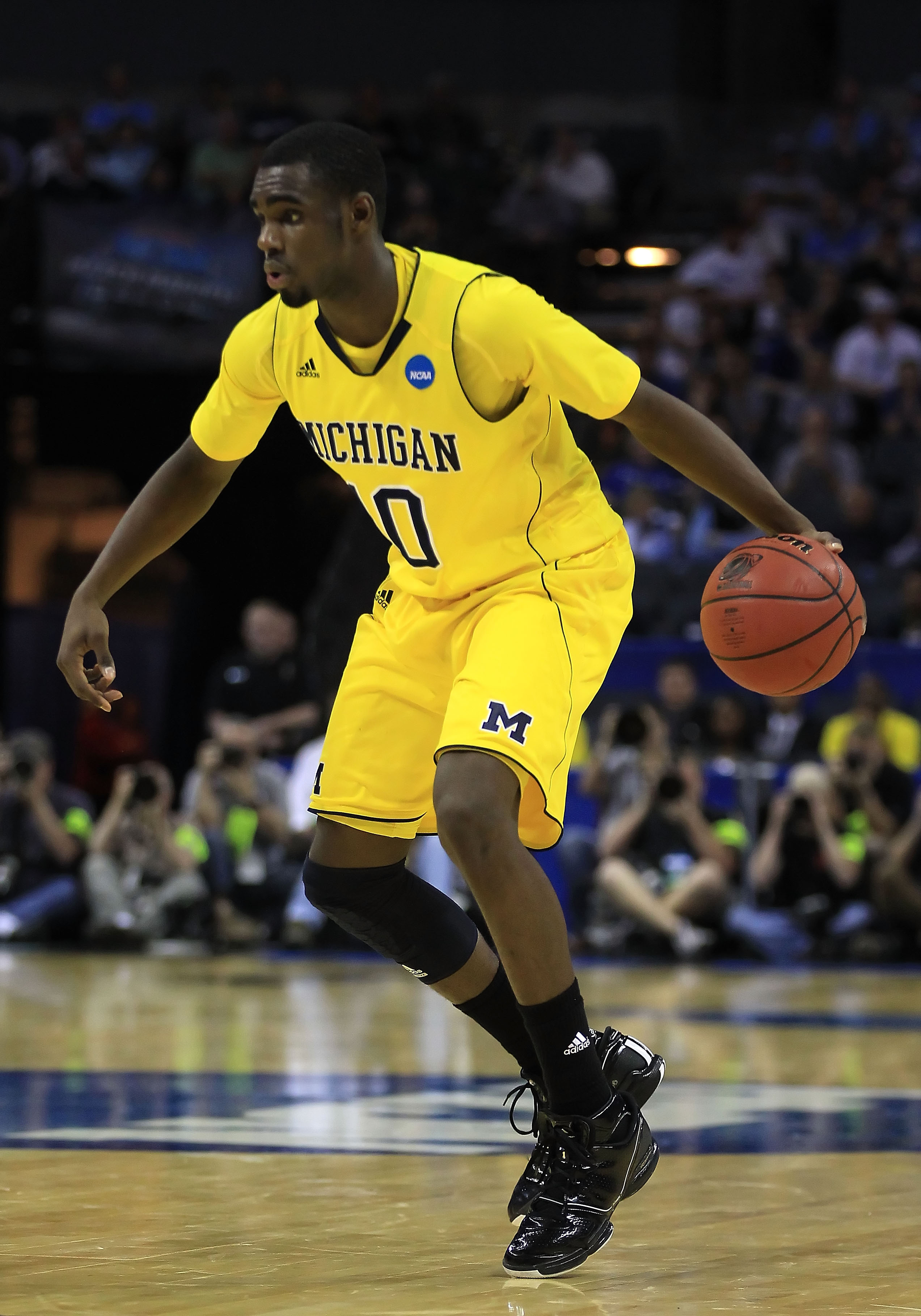 CHARLOTTE, NC - MARCH 20:  Tim Hardaway Jr. #10 of the Michigan Wolverines moves the ball while taking on the Duke Blue Devils during the third round of the 2011 NCAA men's basketball tournament at Time Warner Cable Arena on March 20, 2011 in Charlotte, N