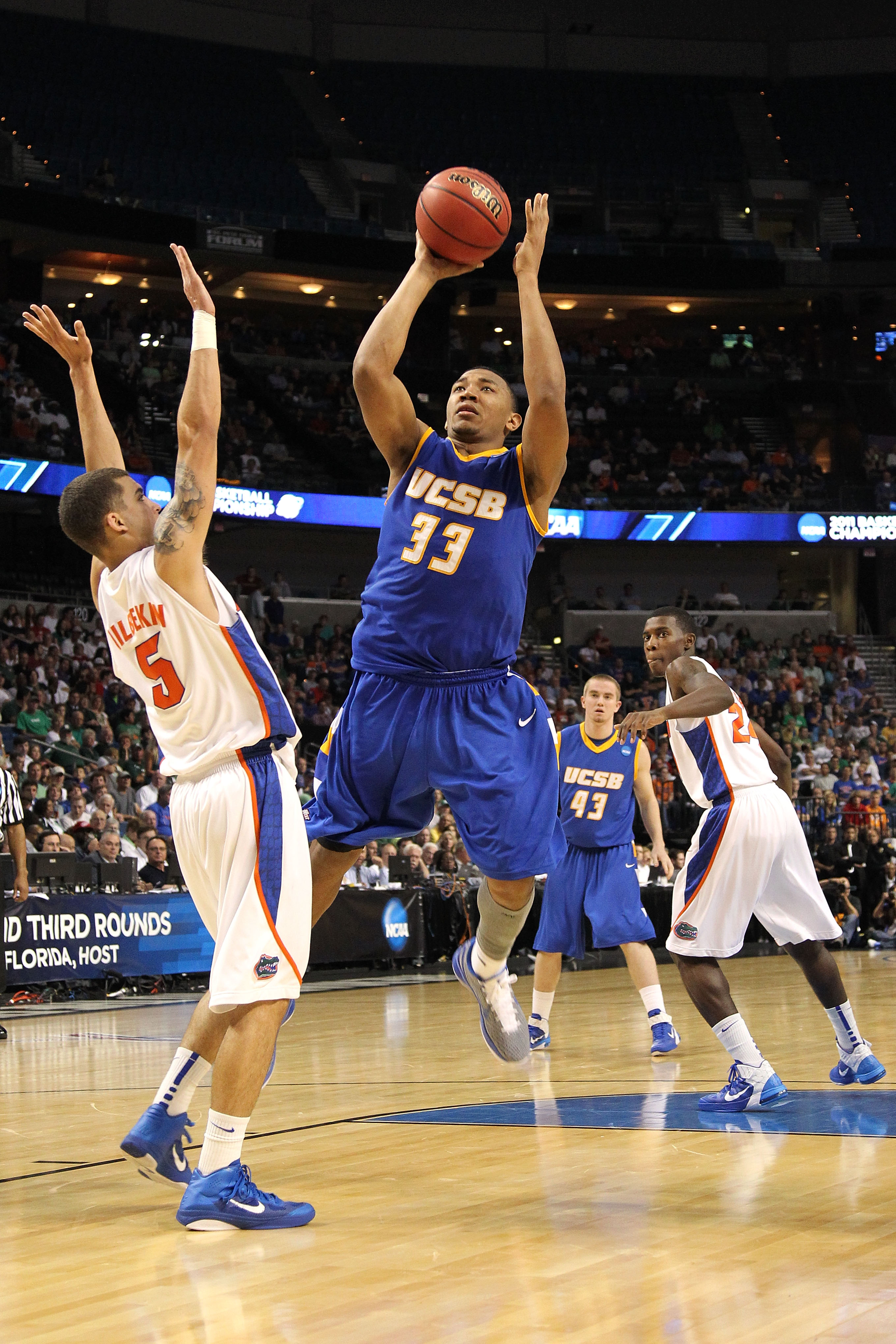 TAMPA, FL - MARCH 17:  Orlando Johnson #33 of the UC Santa Barbara Gauchos drives for a shot attempt against Scottie Wilbekin #5 of the Florida Gators during the second round of the 2011 NCAA men's basketball tournament at St. Pete Times Forum on March 17