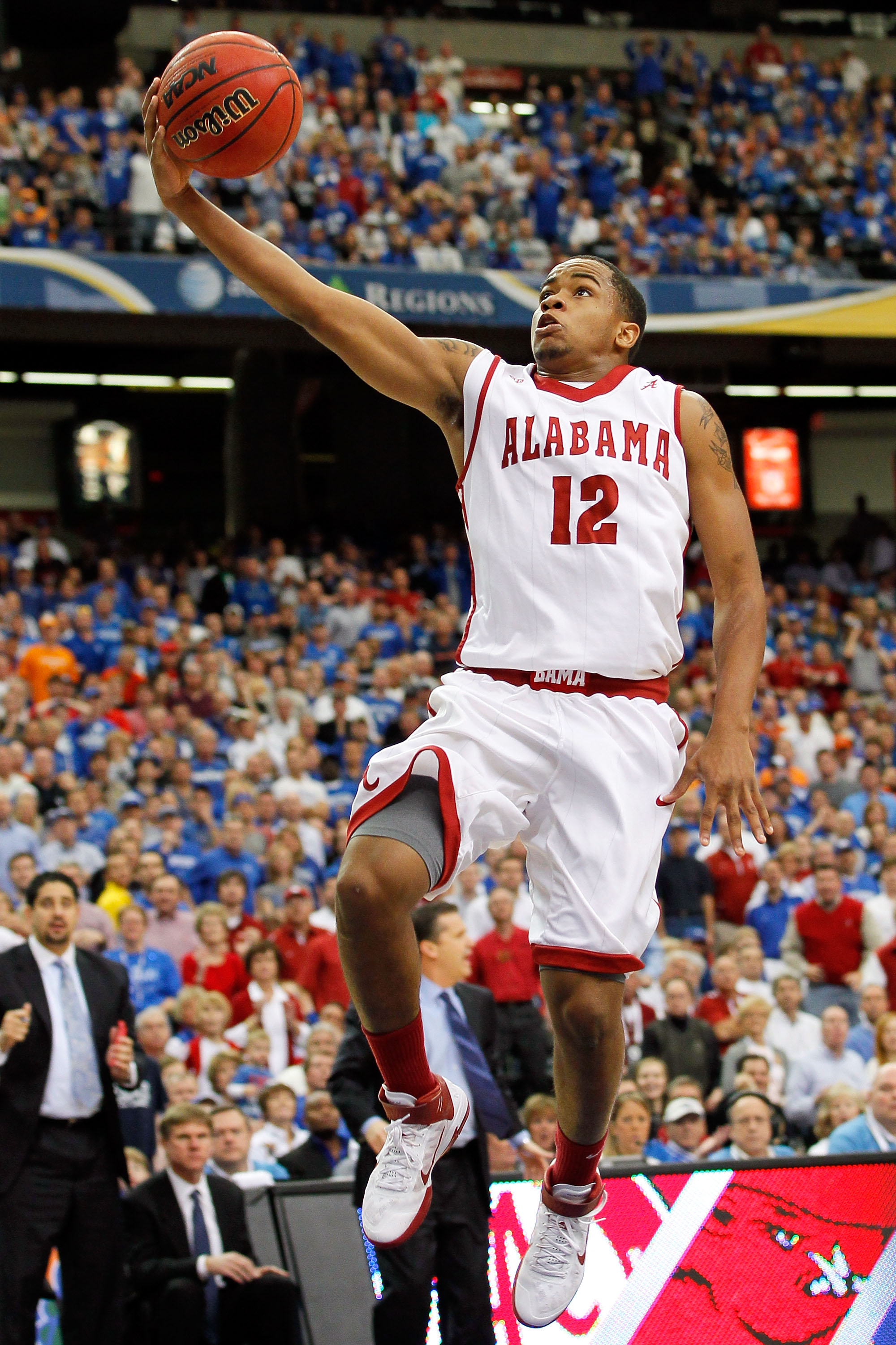 ATLANTA, GA - MARCH 12:  Trevor Releford #12 of the Alabama Crimson Tide shoots against the Kentucky Wildcats during the semifinals of the SEC Men's Basketball Tournament at Georgia Dome on March 12, 2011 in Atlanta, Georgia.  (Photo by Kevin C. Cox/Getty