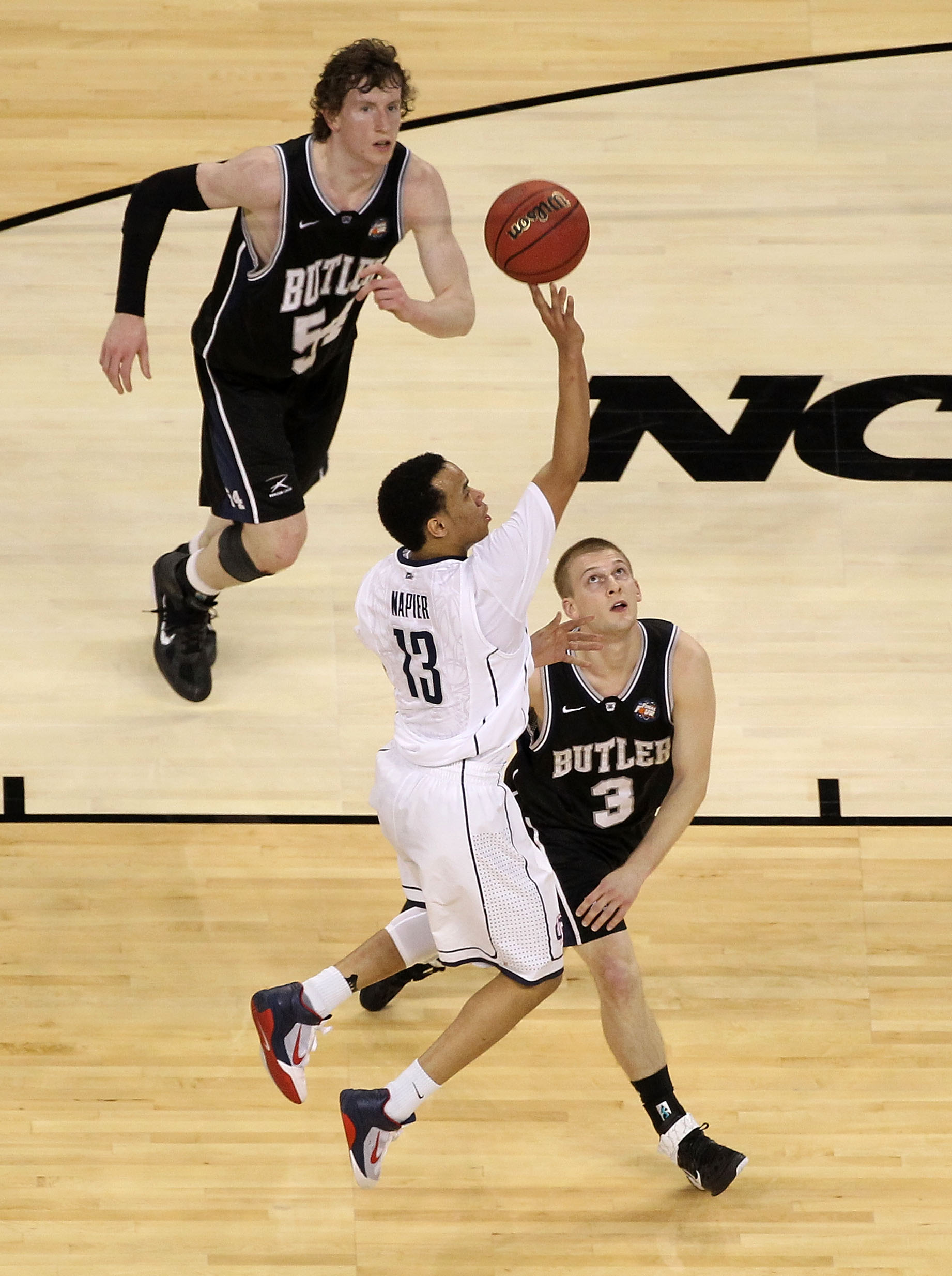 HOUSTON, TX - APRIL 04:  Shabazz Napier #13 of the Connecticut Huskies goes up for a shot over Zach Hahn #3 of the Butler Bulldogs during the National Championship Game of the 2011 NCAA Division I Men's Basketball Tournament at Reliant Stadium on April 4,