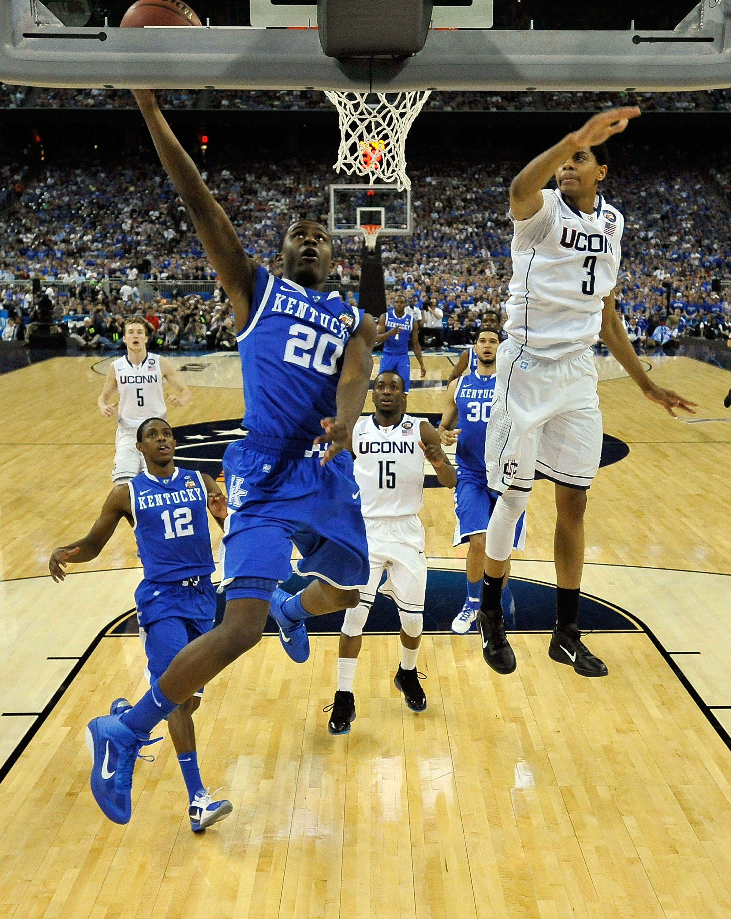 HOUSTON, TX - APRIL 02:  Doron Lamb #20 of the Kentucky Wildcats goes to the hoop against Jeremy Lamb #3 of the Connecticut Huskies during the National Semifinal game of the 2011 NCAA Division I Men's Basketball Championship at Reliant Stadium on April 2,