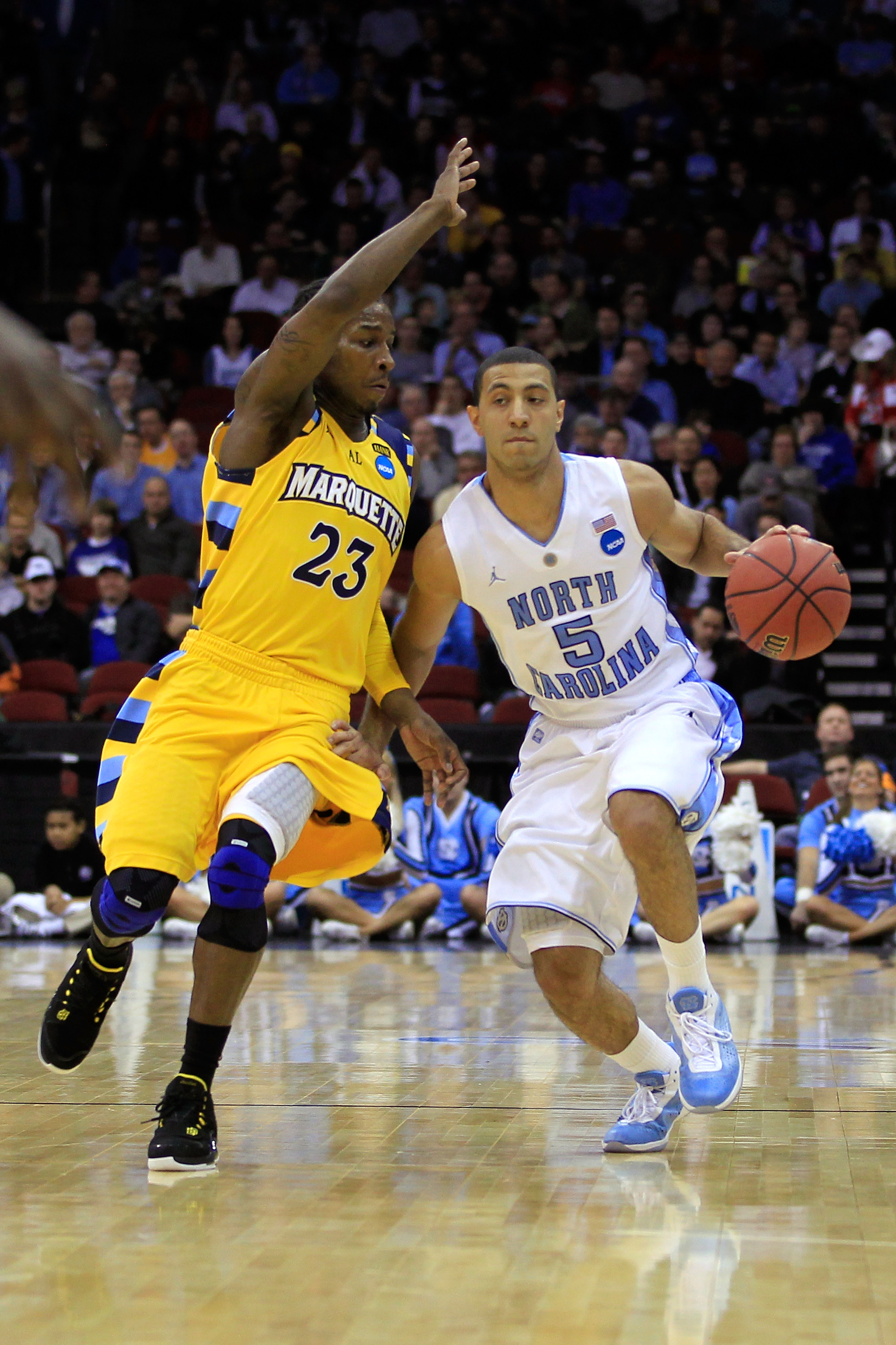 NEWARK, NJ - MARCH 25:  Kendall Marshall #5 of the North Carolina Tar Heels dribbles the ball against Dwight Buycks #23  of the Marquette Golden Eagles during the east regional semifinal of the 2011 NCAA Men's Basketball Tournament at the Prudential Cente