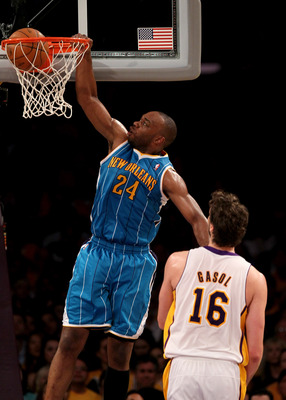 LOS ANGELES, CA - APRIL 17:  Carl Landry #24 of  the New Orleans Hornets dunks over Pau Gasol #16 of the Los Angeles Lakers in Game One of the Western Conference Quarterfinals in the 2011 NBA Playoffs on April 17, 2011 at Staples Center in Los Angeles, Ca