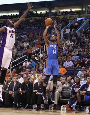 PHOENIX, AZ - MARCH 30:  Daequan Cook #14 of the Oklahoma City Thunder puts up a shot during the NBA game against the Phoenix Suns at US Airways Center on March 30, 2011 in Phoenix, Arizona. The Thunder defeated the Suns 116-98.   NOTE TO USER: User expre