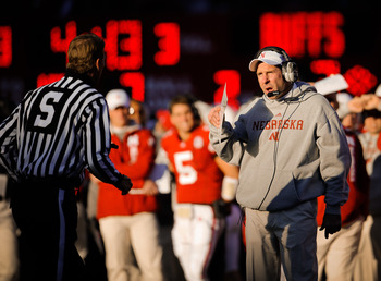 LINCOLN, NE - NOVEMBER 26: Coach Bo Pelini of the Nebraska Cornhuskers chats with a game official during their game against the Colorado Buffaloes at Memorial Stadium on November 26, 2010 in Lincoln, Nebraska. Nebraska defeated Colorado 45-17 (Photo by Er