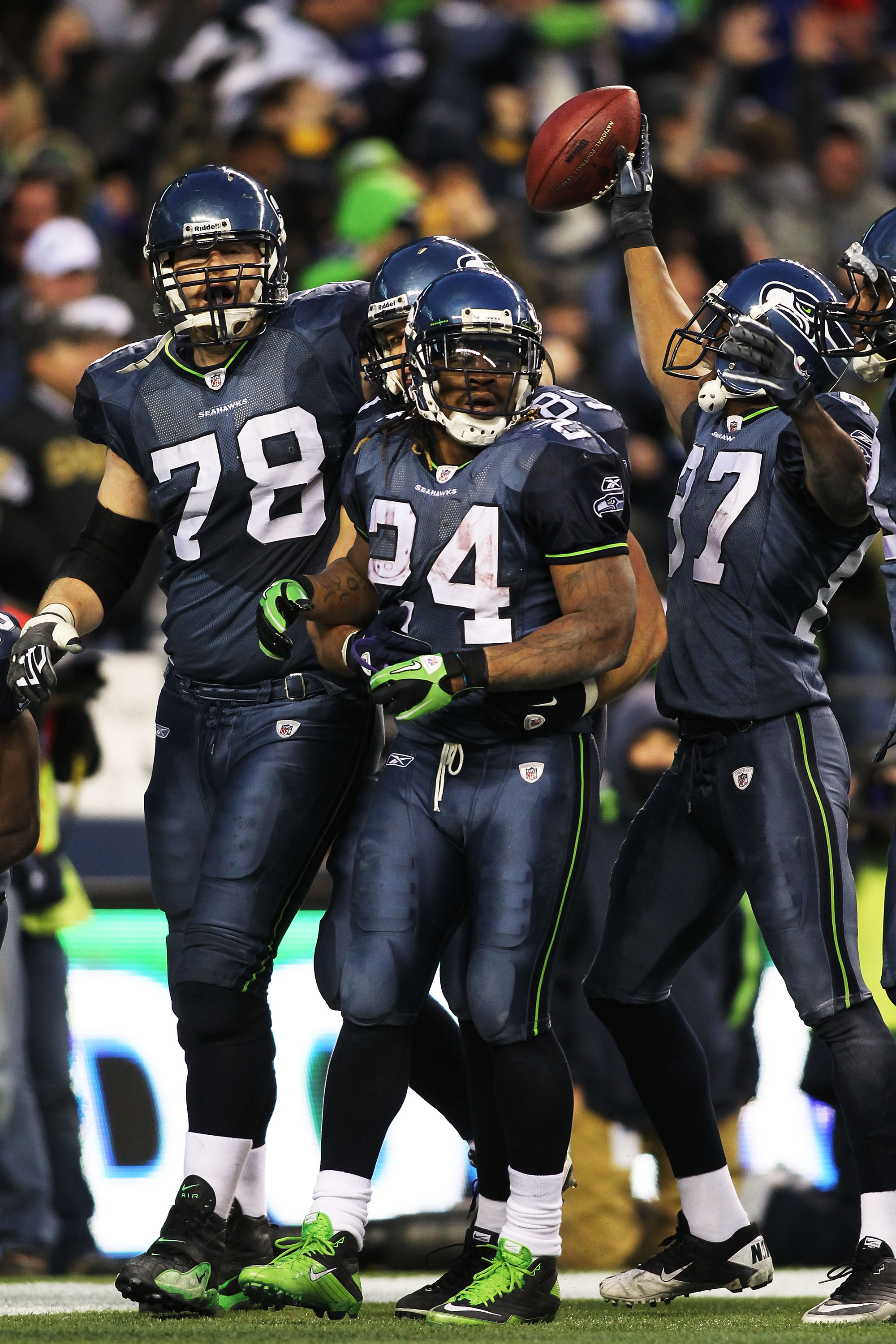 SEATTLE, WA - JANUARY 08:  Running back Marshawn Lynch #24 of the Seattle Seahawks celebrates his 67-yard touchdown run in the fourth quarter against the New Orleans Saints during the 2011 NFC wild-card playoff game at Qwest Field on January 8, 2011 in Se