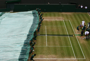 LONDON - JULY 02:  The covers go on as rain delays play during the Men's Quarter Final match between Marat Safin of Russia and Feliciano Lopez of Spain on day nine of the Wimbledon Lawn Tennis Championships at the All England Lawn Tennis and Croquet Club