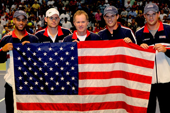 BIRMINGHAM, AL - MARCH 08:  Members of the USA Davis Cup team, James Blake, Andy Roddick, Captain Patrick McEnroe, Mike Bryan, Bob Bryan, pose for photographers after clinching their victory over Switzerland during their tie at Birmingham-Jefferson Conven