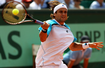 PARIS, FRANCE - MAY 30:  David Ferrer of Spain hits a forehand during the men's singles round four match between David Ferrer of Spain and Gael Monfils of France on day nine of the French Open at Roland Garros on May 30, 2011 in Paris, France.  (Photo by