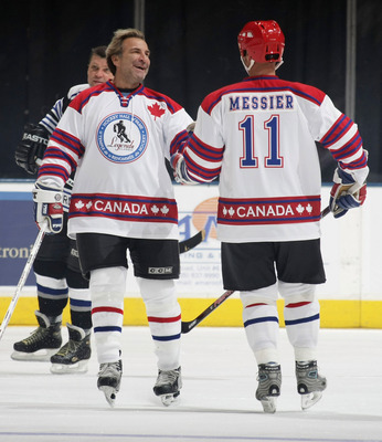 TORONTO, ON - NOVEMBER 08: Glenn Anderson #9 and Mark Messier #11 celebrate a goal by Anderson at the Hockey Hall of Fame Legends Game at the Air Canada Centre on November 8, 2009 in Toronto, Canada. (Photo by Bruce Bennett/Getty Images)